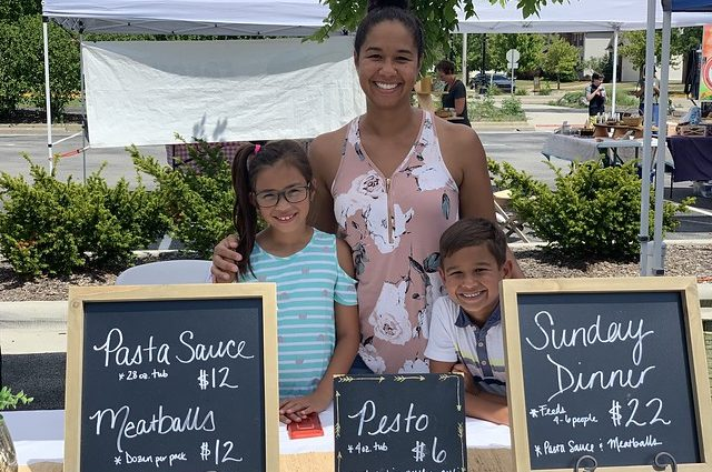 Photo of Taylor Cappelleri and her two children at the West Lafayette Farmer's Market