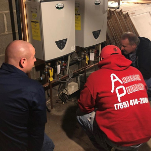Plumbers working on a water heater