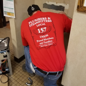 Local 157 Plumber & Steamfitter union member working on a water fountain