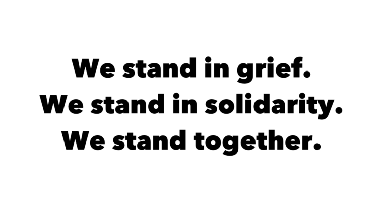 we stand in grief, we stand in solidarity, we stand together