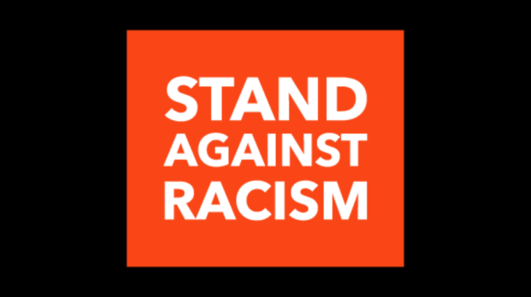black background with the stand against racism 2019 logo
