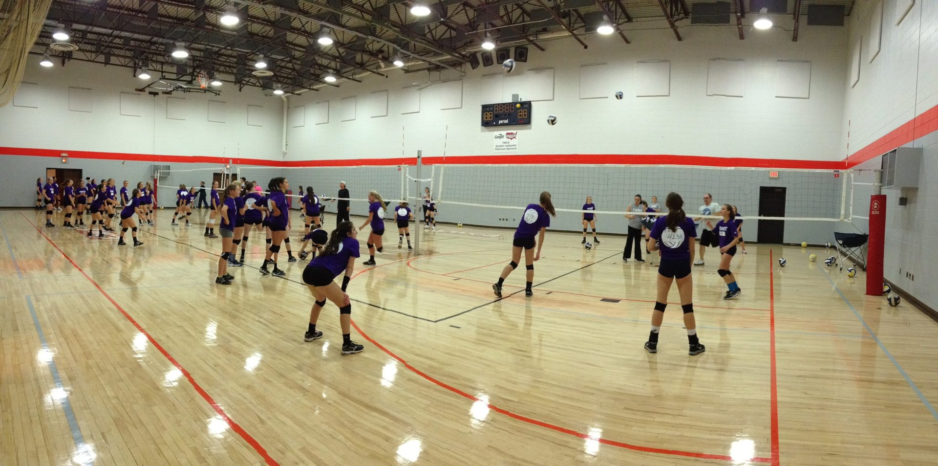 Athletes playing volleyball in the gym
