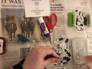a hand is shown working witha set of art supplies and magnetic words