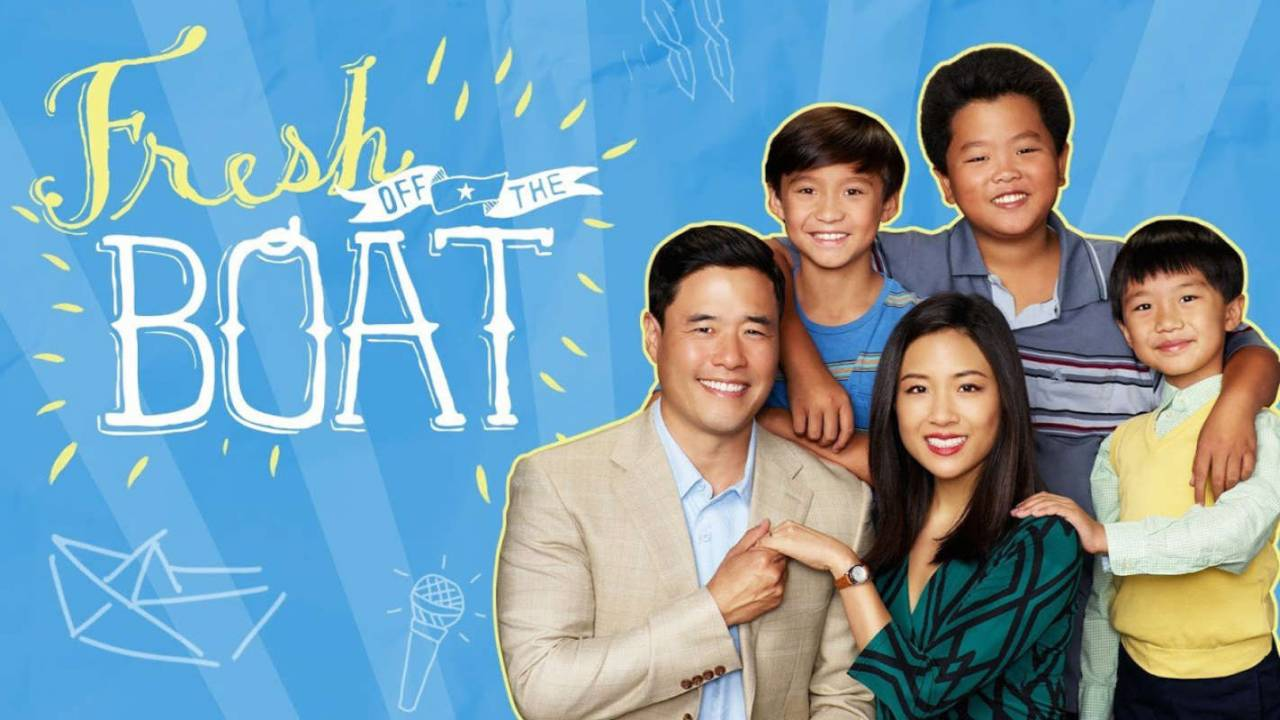 picture of the Huang family from Fresh Off the Boat, set against a blue background with yellow accents.